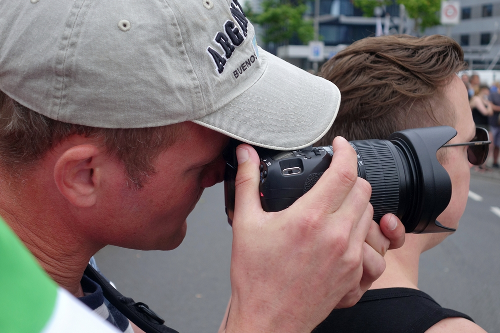 photographer waiting for cycling peloton Tour de France in Rotterdam city 2015