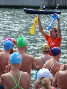 Man giving last instructions to the swimmers