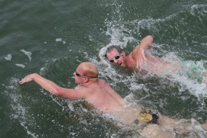 Two swimmers in action together