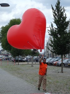 man carrying a big balloon