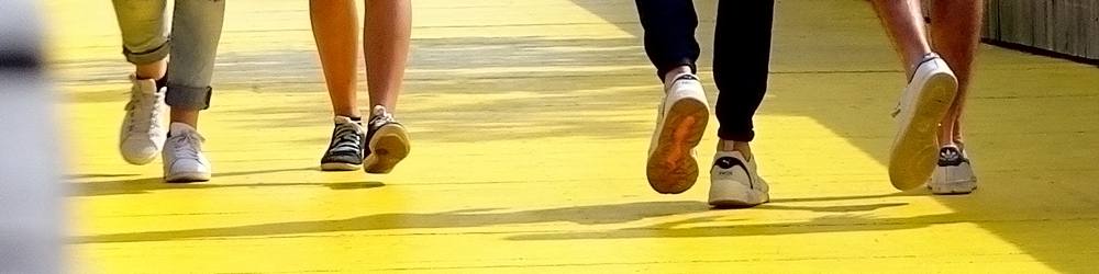Walking feet on the yellow walkway